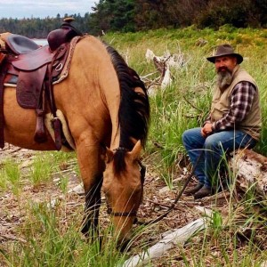 Bill with his buckskin Jasper on a beach ride.